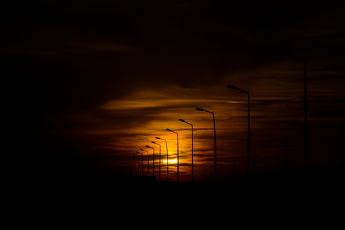 Sunset with street lamps