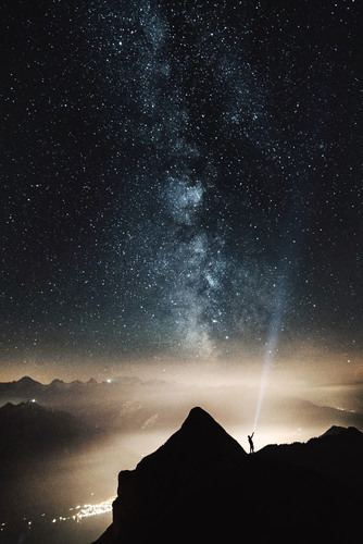 Starry sky with man on mountain