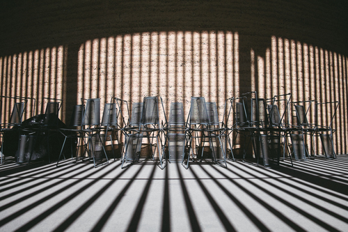 Chairs against shadowed wall