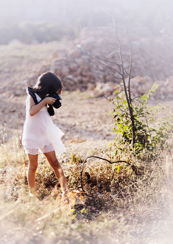 Child photographer in nature