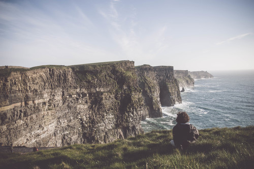 Man watching the Cliffs of Moher