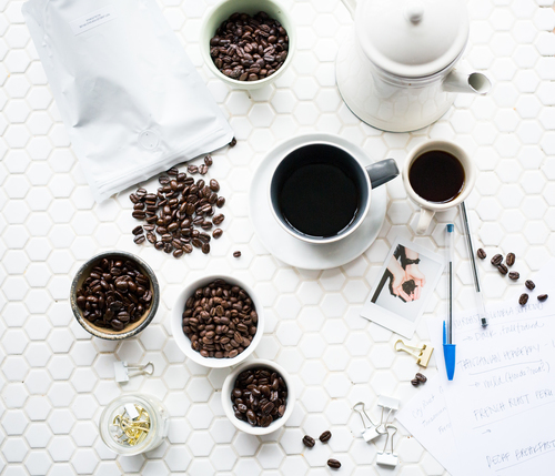 Coffee beans and mugs