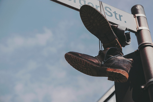 Shoes hanging on a street sign