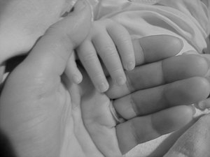 Hands of A Mother And A Baby