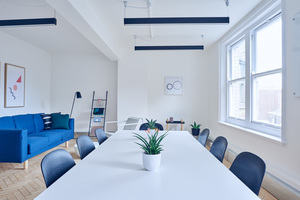 Meeting table with blue chairs