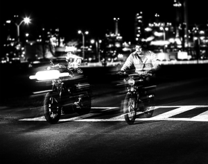Two bikers on the street