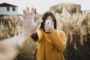 Girl taking pictures with iPhone