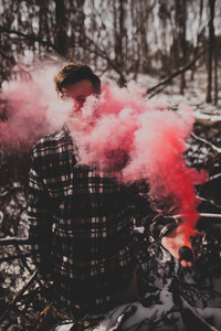 Man in pink smoke