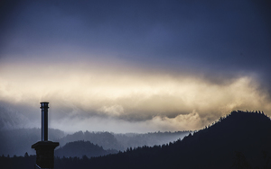 Chimney and foggy landscape