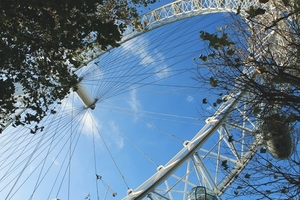 Observation wheel against blue sky