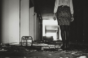 Woman walking in the abandoned building