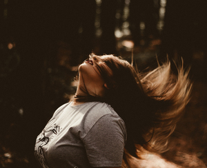 Woman tossing hair