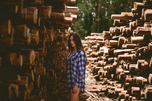Woman with wood logs