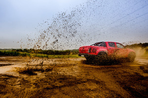 Car driving through mud