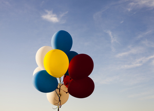 Colorful balloons under blue sky