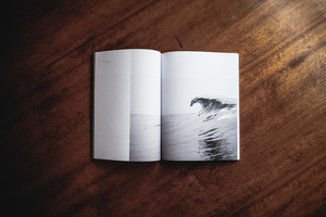 Opened book with a photo