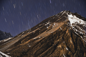 Snowy mountain with falling stars