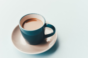 White coffee in blue mug