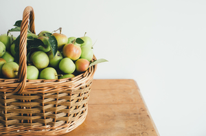 Apples in basket on table