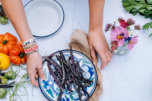 Purple beans on colorful plate and table