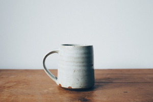 Single mug on desk