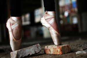 Ballerina's legs on bricks