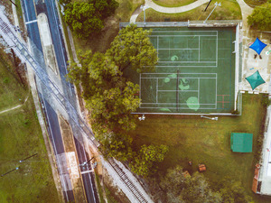 Road, railway and tennis court