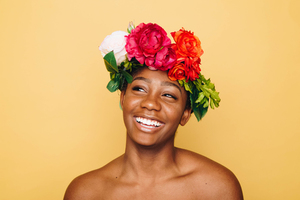 Smiling girl with hair flowers