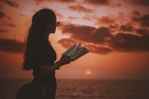 Japanese girl reading in sunset