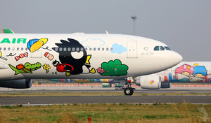 Airplane with cartoon drawings