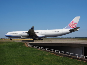 Airplane of China Airlines taxiiing on the airport
