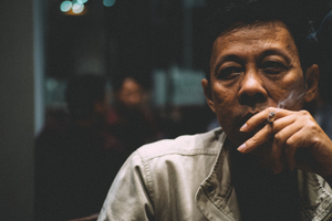 Indonesian guy smoking