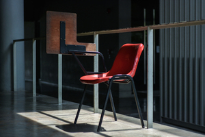 Red chair in sunlight