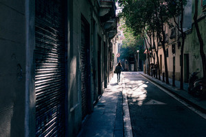 Shadow street in Barcelona, Spain
