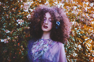 Curly girl in flowers