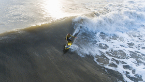 Surfer on big wave