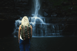Blond girl and waterfall