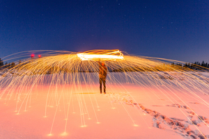 Man in snow with firecrackers
