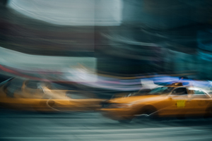 Blurry yellow taxi cab