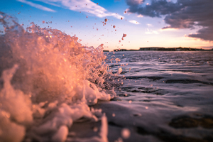 Splashing waves in sunset image