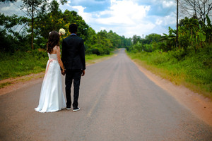 Bride and groom on rural road