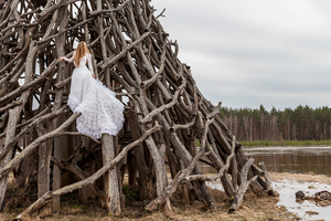 Bride climbs wood structure