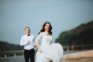 Bride running from groom