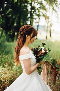 Bride with a diverse bouquet