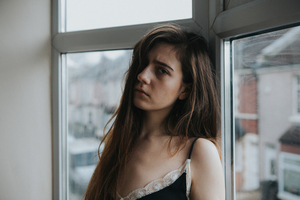 Sad female by the window