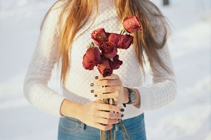 Dried flowers in hands