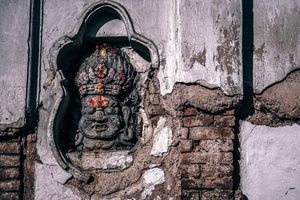 Buddhist God carved in wall
