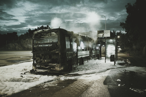 Burned down bus in snow