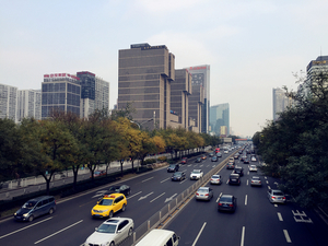 Busy daytime traffic in Guomao