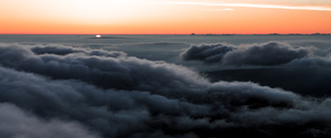 Sunrise above clouds